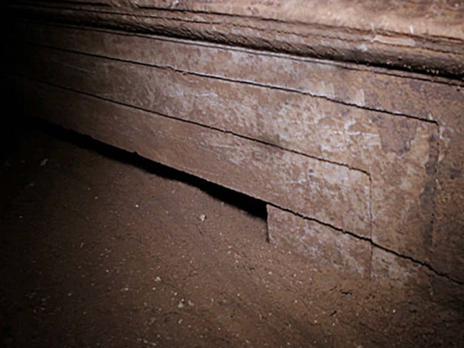 What lies beneath ... Reports suggest a colourful decoration has been glimpsed behind this Ionic-style doorway guarding the Amphipolis tomb's third chamber.