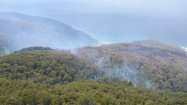 The fires along Great Ocean Rd have been described as a 'sleeping giant'. Picture: Mitch Bear
