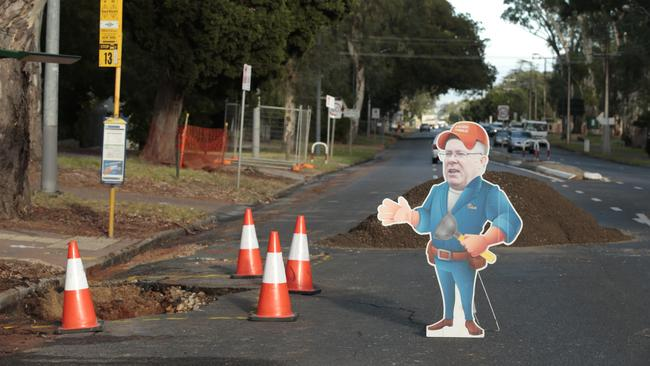 A cutout of Water Minister Ian Hunter at a burst water main in Hazelwood Park. Picture: Tait Schmaal.