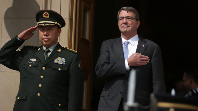 China's General Fan Changlong and Secretary of Defense Ashton Carter listen to the US national anthem at the Pentagon. Picture: Alex Wong/Getty Images