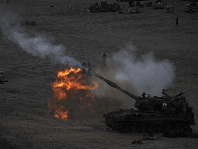 No let up ... an Israeli tank fires a 155mm shell towards targets in the Gaza Strip from their position near Israel's border with the Palestinian enclave. Picture: David Buimovitch