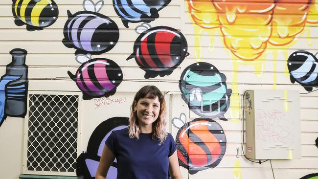 West End will get a colourful coat of paint thanks to a new street art festival. Cass Kowitz is pictured in front of a mural at The Burrow. Picture: Mark Cranitch