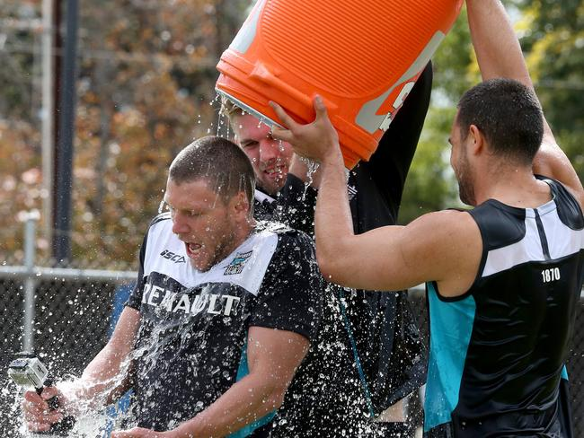 Ice water bucket Challenge — Port Adelaide Players accept the challenge from their president David Koch at Alberton Oval. Jackson Trengove and Alipate Carlile get Brad Ebert. Photo Sarah Reed.