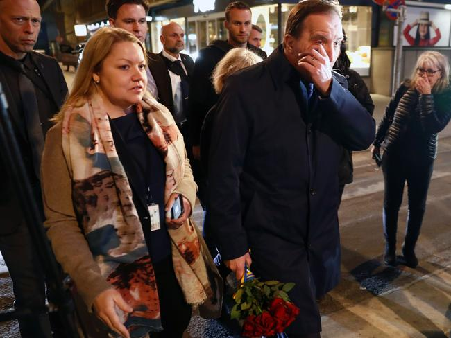 Swedish Prime Minister Stefan Lofven sheds a tear as he arrives to lays flowers at the scene of the attack.