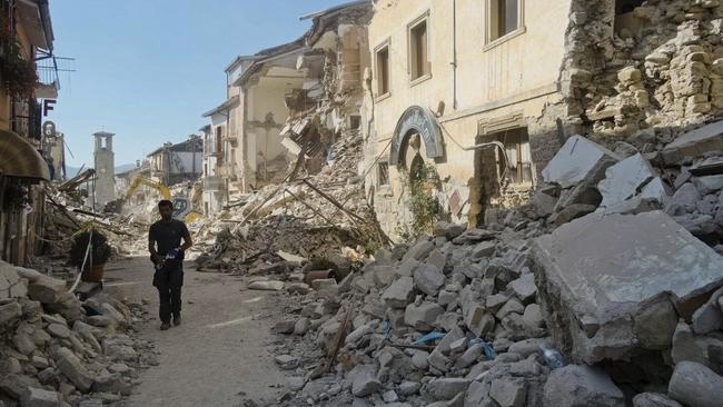 A man walks in a street in Amatrice, central Italy, where a 6.2 earthquake struck just after 3:30am, on August 24, 2016. Picture: Emilio Fraile.