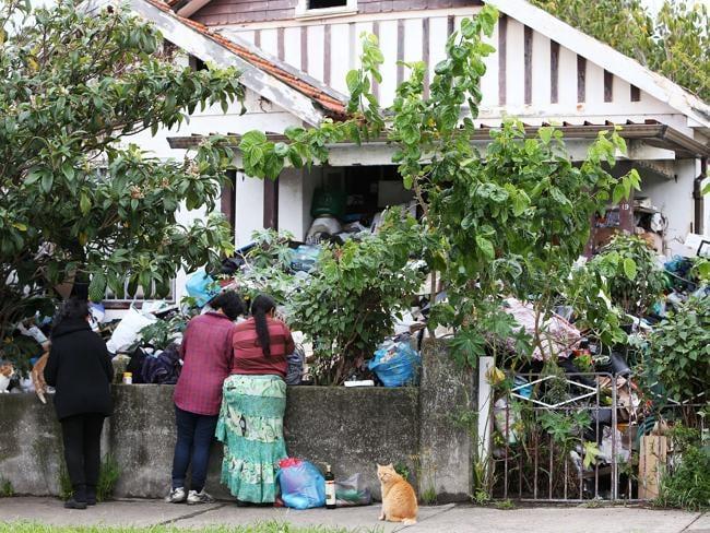 Mary Bobolas and her daughters Elena and Liana outside their house on Boonara Avenue, Bondi.