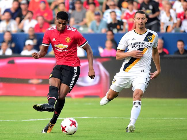Marcus Rashford of Manchester United scores.