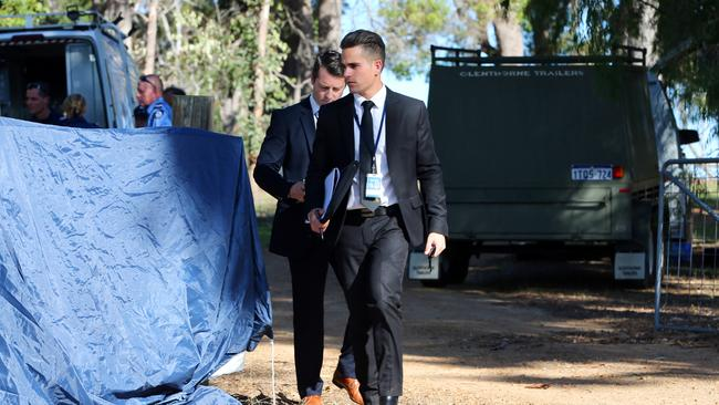 Officers on the scene of the incident earlier on Friday. Picture — Justin Benson-Cooper / The West Australian