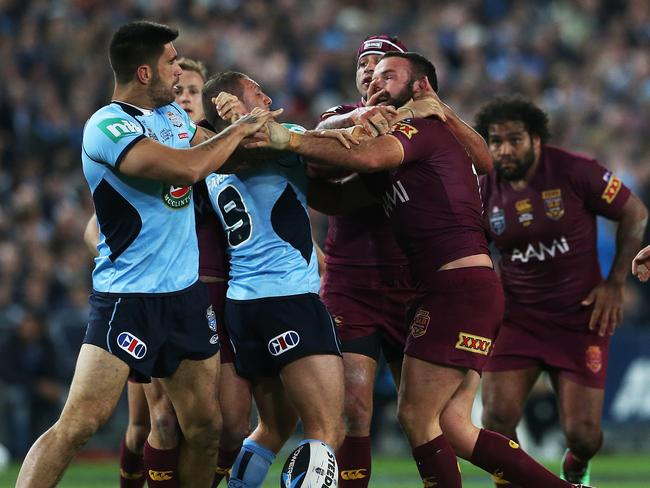 NSW's James Tamou and Queensland's Nate Myles get involved in some push and shove in State of Origin II.