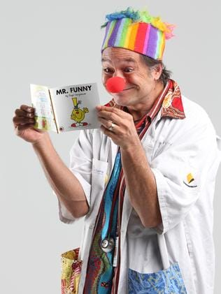 Dr Munjong reading his Mr Funny book from the Mr Men series. Photo: Ross Swanborough.