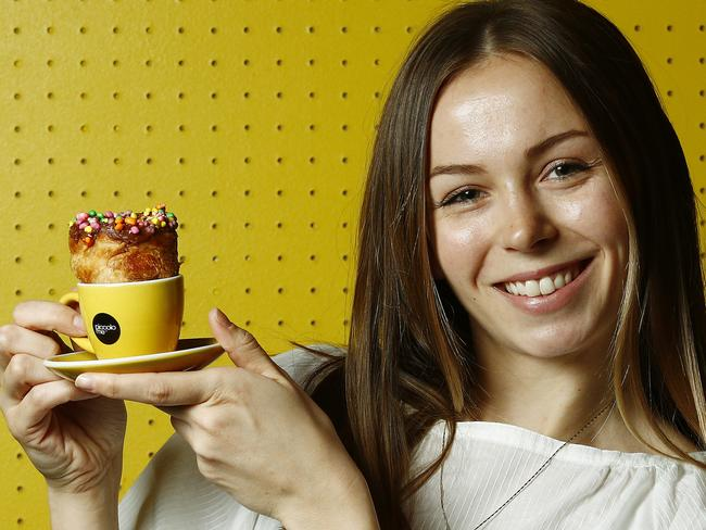 Zara Jennings tries a Crospresso, which is a nutella croissant and espresso combination at Piccolo Me. Picture: John Appleyard