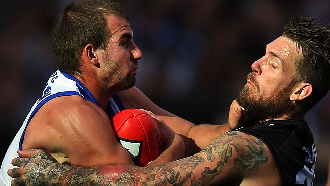 North Melbourne midfielder Ben Cunnington is tackled by Collingwood star Dane Swan. Pictu