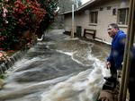 Aldgate RSL is flooded as the banks of the creek burst. - past president and RSL life member Jeff Barrett watches as the water flows in. Picture: Tricia Watkinson