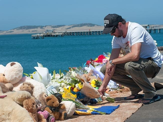 The brother of Damien Little, Shannon Little, visits the growing memorial site at Port Li