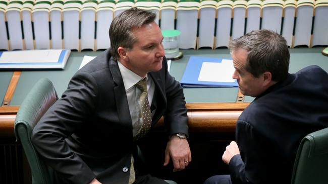 Cuts slammed ... Shadow Treasurer Chris Bowen and Opposition Leader Bill Shorten chat during Question Time.