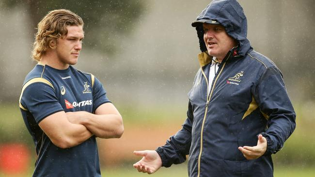 Michael Hooper talks to Ewen McKenzie during a Wallabies training session in Sydney this week.