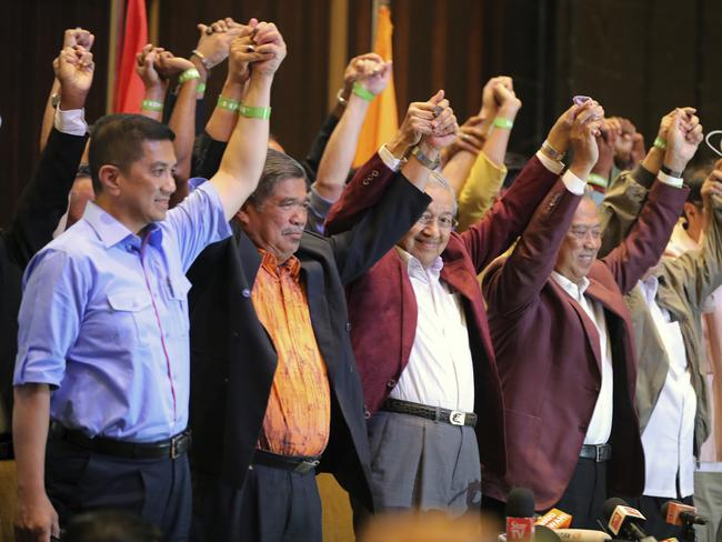 Mahathir Mohamad, third left, celebrates at a hotel in Kuala Lumpur. Picture: AP