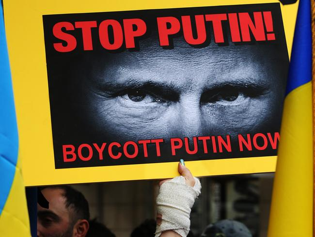 Protesters in Sydney yesterday demanded the Russian President Vladmir Putin not be allowed into Australia for the G20 meeting in November.