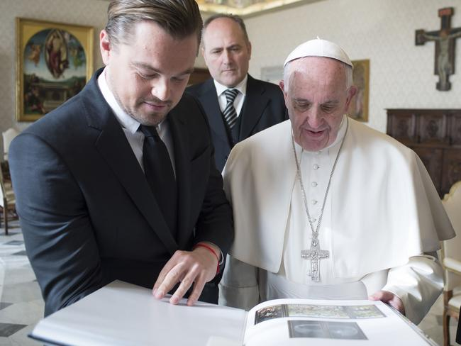 Touching moment ... Pope Francis exchanging gifts with US actor Leonardo DiCaprio during a private audience at the Vatican. Picture: AFP/Osservatore Romano