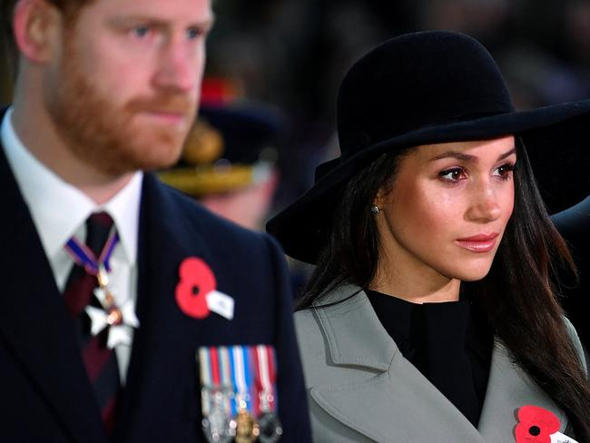 Prince Harry and his fiancee Meghan Markle attend an Anzac Day dawn service at Hyde Park Corner in London. Picture: AFP/Pool/Toby Melville
