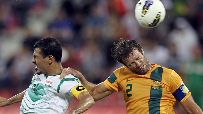 WORLD Cup football qualifier, Iraq v Australia in Doha, Qatar. Australia won 2-1: Iraq's Younus Mahmood, left, challenges Lucas Neill. Picture: Osama Faisal