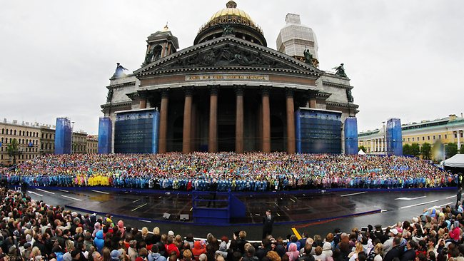 Crowds gather to watch the 4,335 strong choir of St. Petersburg perform a mass choir program near the citys famed St. Isaacs Cathedral to honour the citys 310th anniversary and in an attempt to set a Guinness wold record. Picture: AP