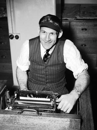 Richmond's Jack Dyer at a typewriter. Picture: Herald Sun Image Library