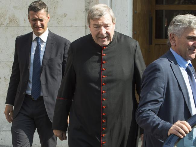 Cardinal George Pell (centre) leaves his home in The Vatican in Rome to hear if Victorian police would prosecute him. Picture: Ben Stevens.