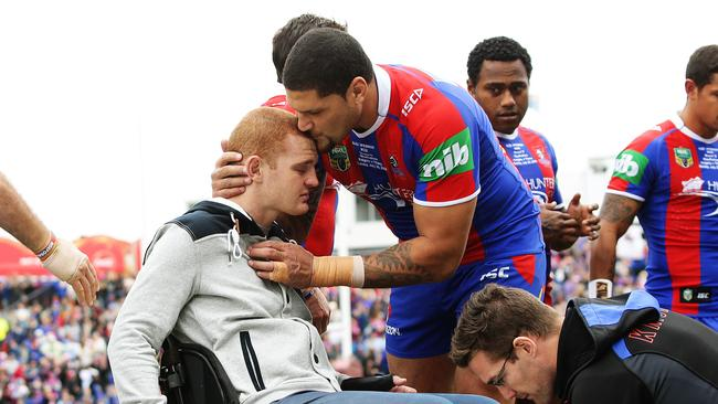 Alex McKinnon sheds a tear with Willie Mason at the Rise for Alex game. Picture: Brett Costello