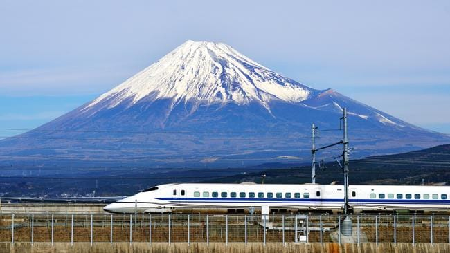 The Tokaido Shinkansen passing by Japan's Mt Fuji.