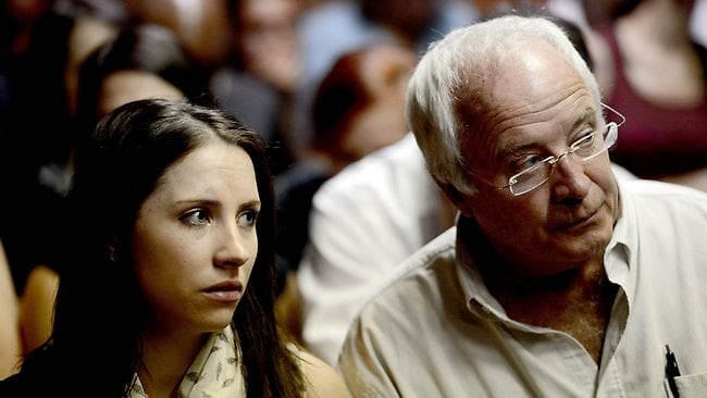 Henke Pistorius (R) and Aimee Pistorius (L) attend the appearance of their son and brother South African Olympic sprinter Oscar Pistorius on February 19, 2013 at the Magistrate Court in Pretoria. Pistorius battled to secure bail as he appeared on charges of murdering his model girlfriend Reeva Steenkamp on February 14, Valentine's Day. South African prosecutors will argue that Pistorius is guilty of premeditated murder in Steenkamp's death, a charge which could carry a life sentence. AFP PHOTO / STEPHANE DE SAKUTIN
