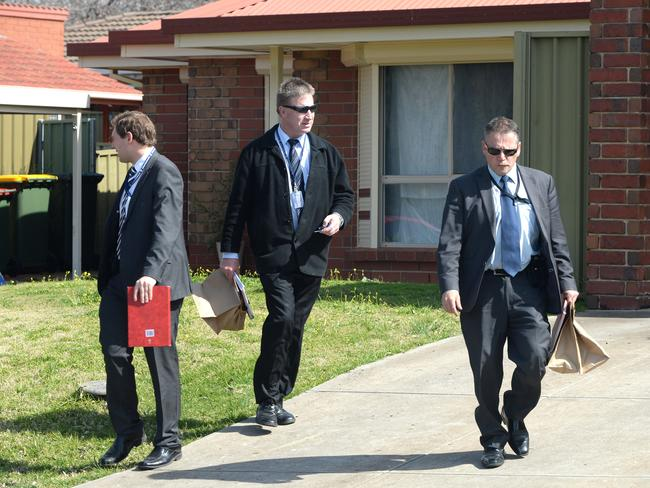 Police at the house in Golden Grove, where a woman was sexually assaulted. Picture: David Cronin
