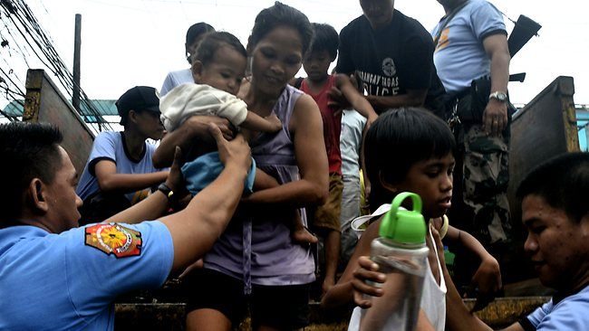 Residents living near the slopes of Mayon volcano are evacuated to public schools by police in anticipation of the powerful typhoon Haiyan that threatened Albay province and several provinces in central Philippines.