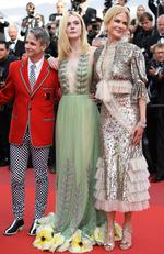 "Director John Cameron Mitchell and Actresses Elle Fanning and Nicole Kidman depart after the ""How To Talk To Girls At Parties"" screening during the 70th annual Cannes Film Festival at Palais des Festivals on May 21, 2017. Picture: Getty"