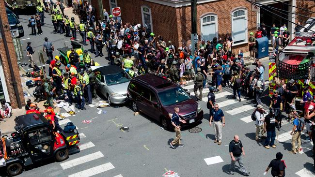 People receive first-aid after a car ran into a crowd of protesters in Charlottesville. Picture: AFP/Paul J Richards