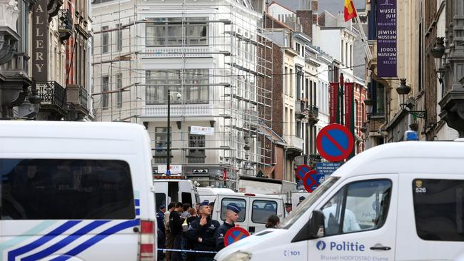 Chaotic ... police shut down a street where the lone gunman killed three people at a Jewish museum in Brussels. Picture: AFP