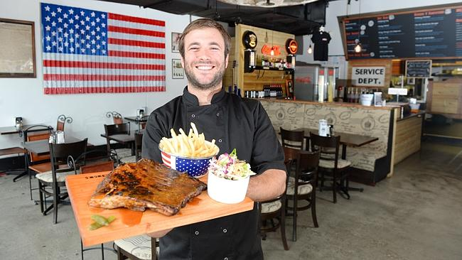 Jesus Gimeno shows off some staples at Smokey's All American BBQ. Photo: Josie Hayden
