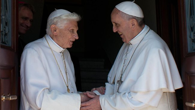 Pope Francis (R) with his predecessor, Pope Benedict.