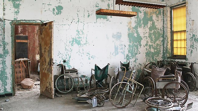 Piles of discarded wheelchairs in a New York asylum. Photo: Julia Wertz.