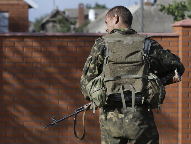On guard ... A Ukrainian soldier in the village of Bezimenne, eastern Ukraine. Source: AP