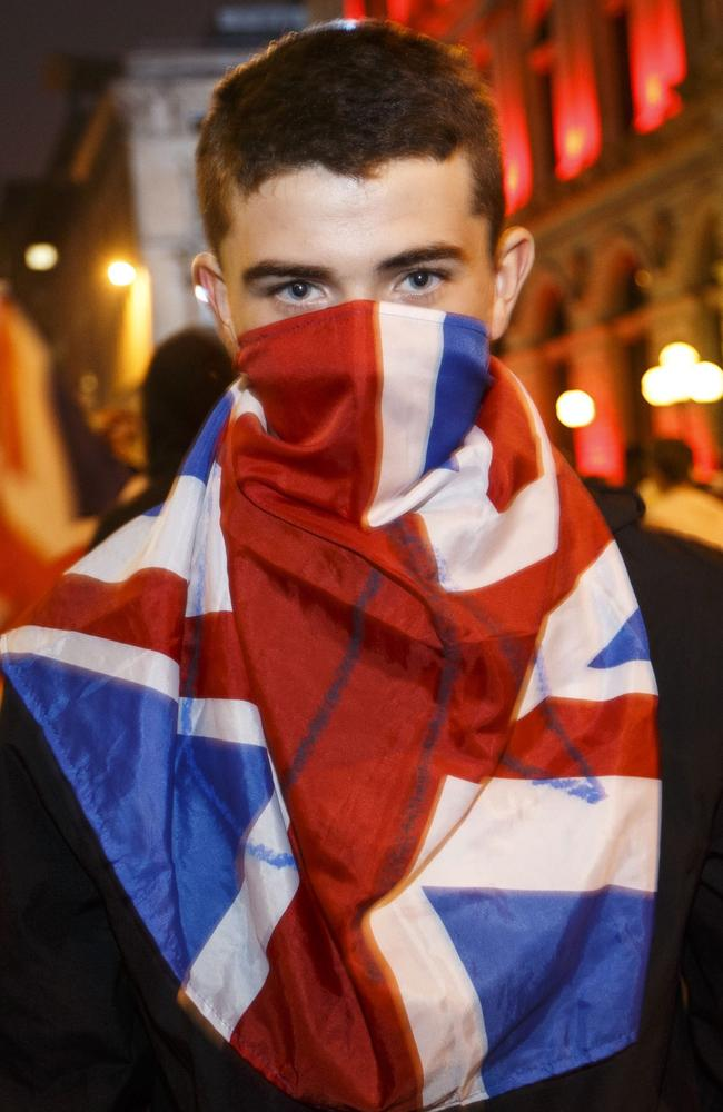 "A ""No"" supporter wears a Union Jack on his face."