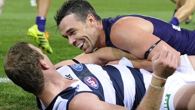 Ryan Crowley has a chat with Steve Johnson after a tackle. Picture: Daniel Wilkins