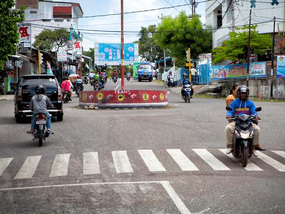 flores, indonesia - April 27, 2016: road full of traffic in a city in flores, indonesia