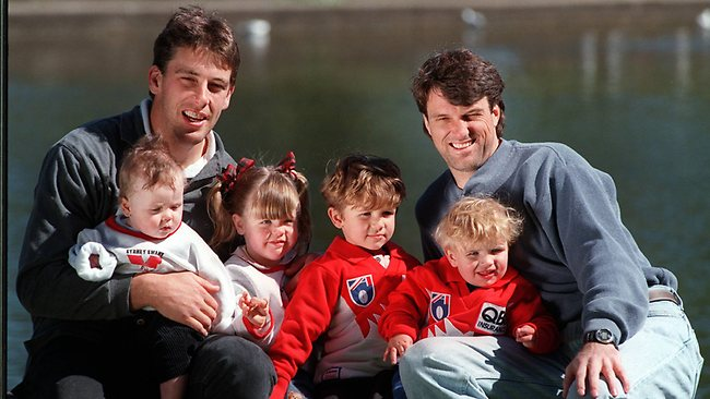 Former Sydney Swans AFL players Paul Roos (R) with his sons Dylan (3) & Tyler (17months) and Andrew Dunkley with daughter Lara (2) & son Joshua (7months). Picture: Tracey Haslam
