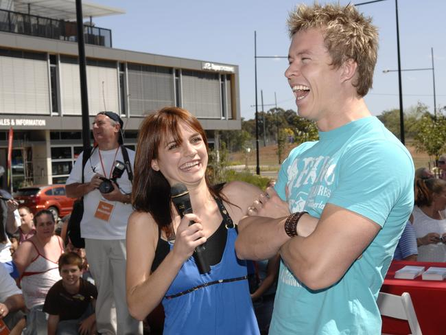 Home and Away stars Jessica Tovey and Todd Lasance share a laugh at a community event in 2008. Picture: News Corp Australia