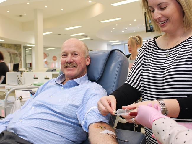 Mark Kelly getting booster shot, with Australian Red Cross Blood Service Anti-D co-ordinator Jessie Wallis.