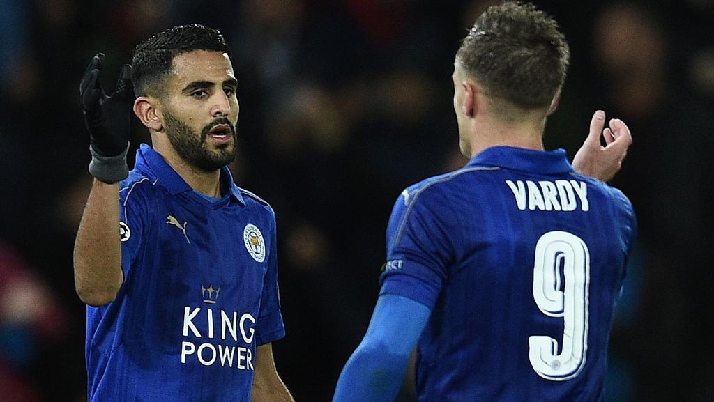 Leicester City's Algerian midfielder Riyad Mahrez (L) celebrates with Jamie Vardy.