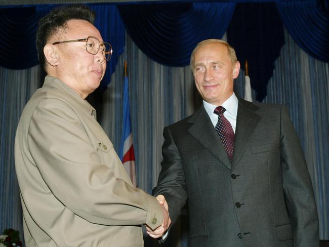 Russian President Vladimir Putin shakes hands with former North Korean leader Kim Jong Il during a meeting in Vladivostok, 2002. Picture: AFP Photo/Alexander Nemenov