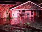 A flooded home on Kensington Rd, Toorak Gardens. The colour is reflections from an emergency services vehicle. Picture: Campbell Brodie