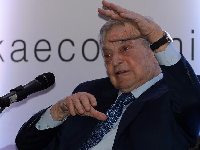 Hungarian-born US magnate and philanthropist George Soros attends an economic forum in Colombo on January 7, 2016. AFP/lakruwan wanniarachchi.
